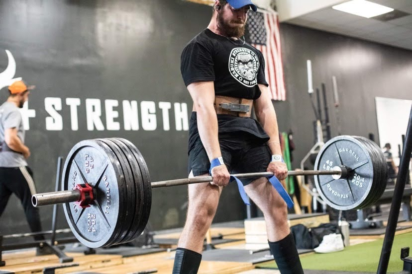 Unleash'd Strength Gym Member Deadlifting 405 pounds